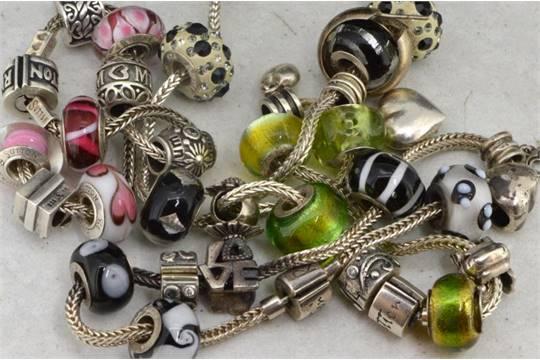 f6385c0fd4d15 Four silver Rhona Sutton charm bracelets, with a large quantity of ...
