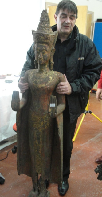 Lot 85 - A South-East Asian wooden figure Representing a Khmer style standing Buddha with hands in double