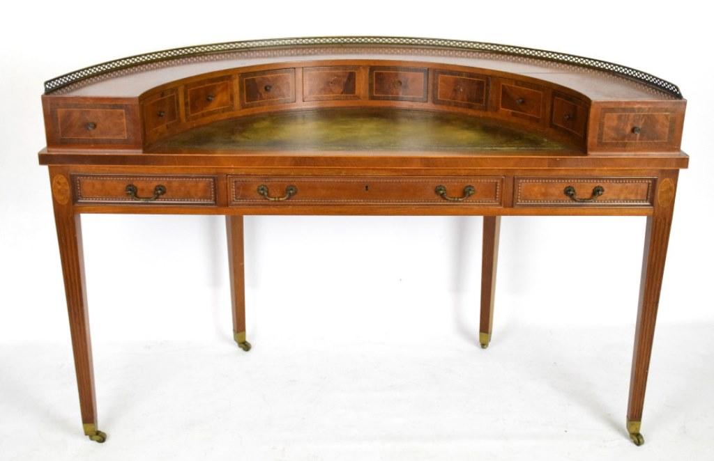 Regency style demilune desk having a green leather top writing desk