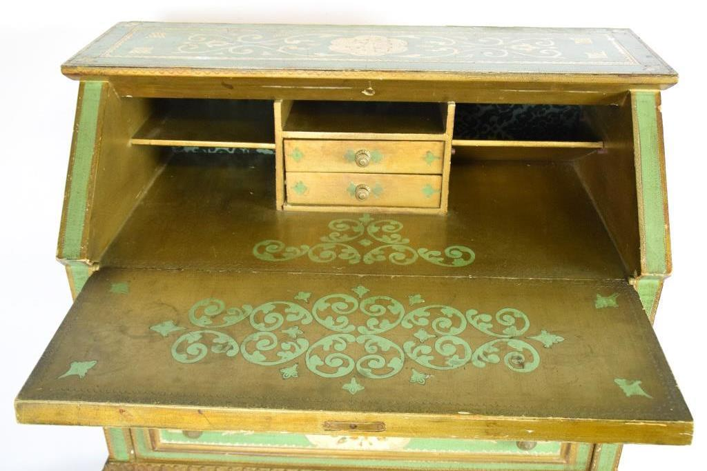 20th century decorative having a green painted finish with floral