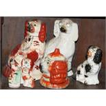 """A Staffordshire dog, 10"""" high, five others, in various sizes, and a similar pot with lid"""