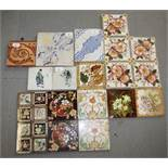 An 18th century Delft blue and white floral decorated tile, an Intarsia tile and a quantity of other