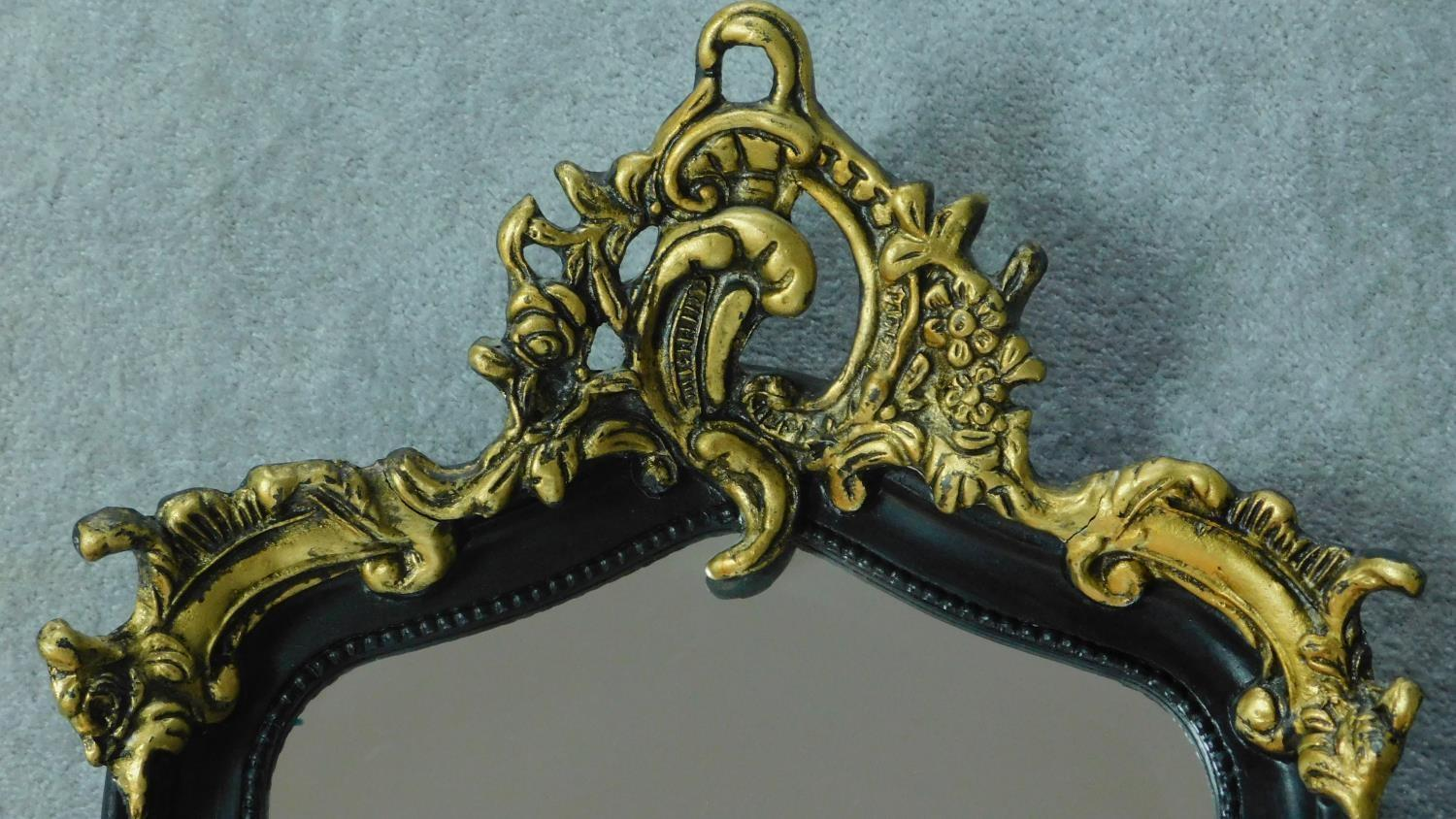 A rococo style gilt and ebonised pier mirror. 115x52cm - Image 3 of 4