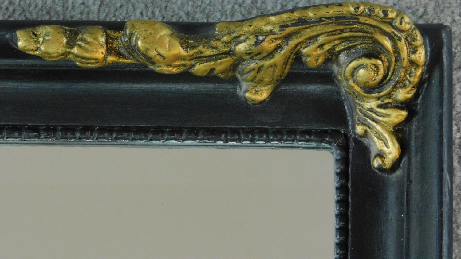 A rococo style gilt and ebonised pier mirror. 115x52cm - Image 2 of 4