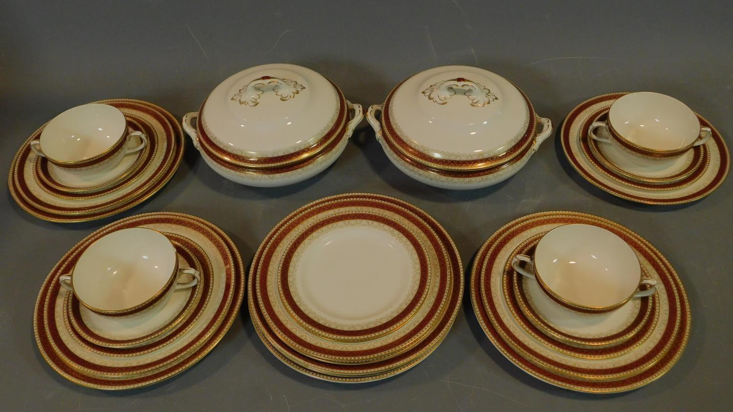 A Loselware part dinner service, dinner plates, side plates, soup bowls, tureens etc.