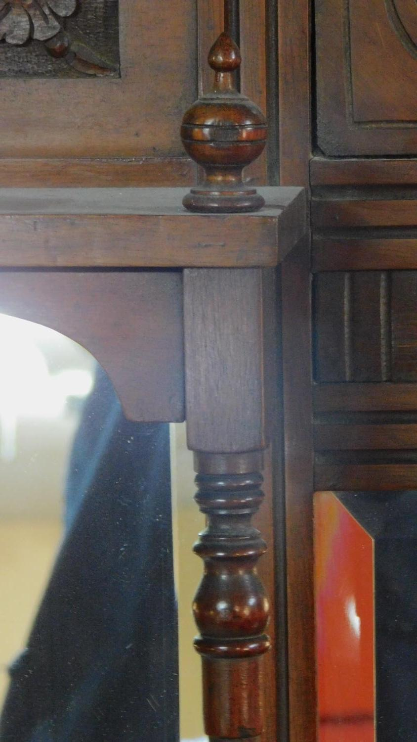 A Victorian carved walnut overmantel with broken arch pediment. H.135 W.111 D.16cm - Image 5 of 6