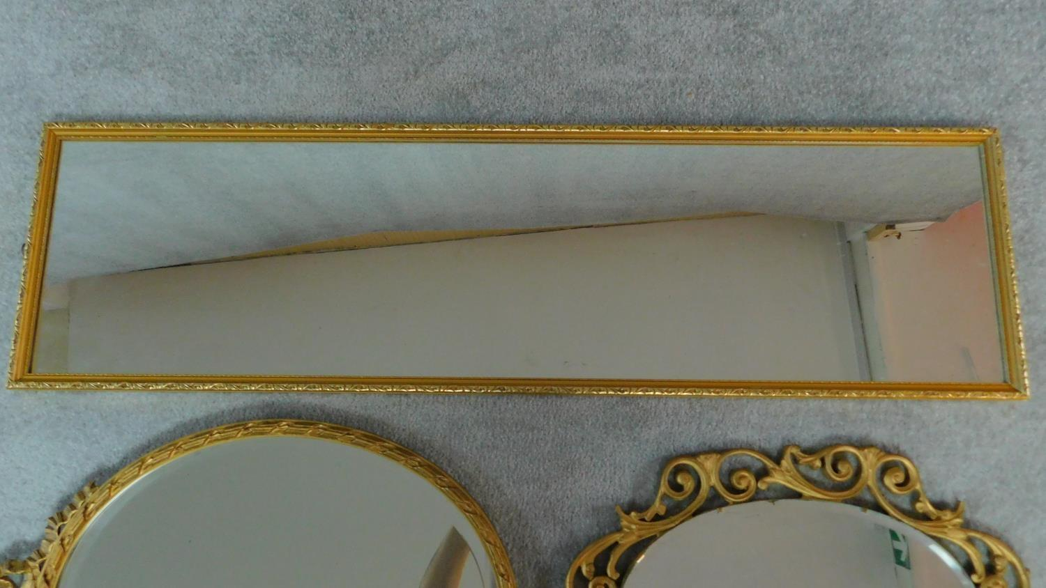 A rectangular gilt wall mirror and two oval gilt mirrors. 120x34cm - Image 4 of 5