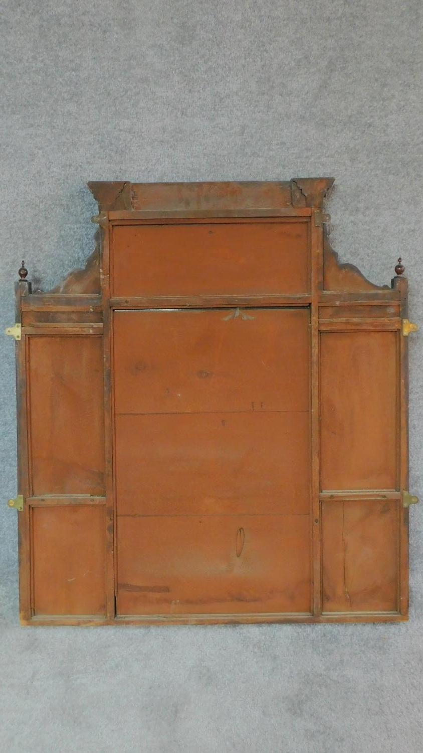 A Victorian carved walnut overmantel with broken arch pediment. H.135 W.111 D.16cm - Image 6 of 6