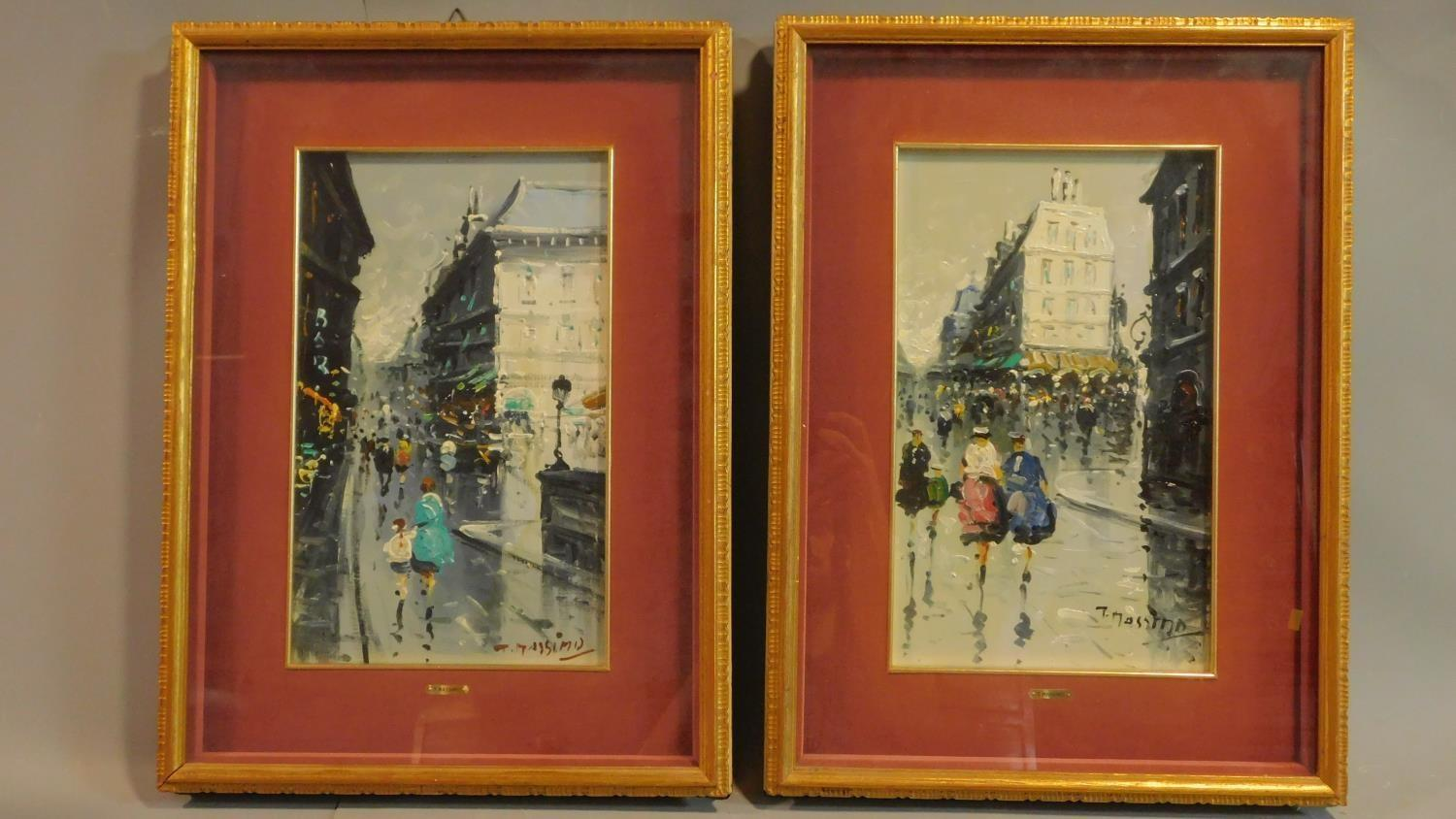 A pair of framed and glazed oils on board, continental street scenes in the rain, signed T