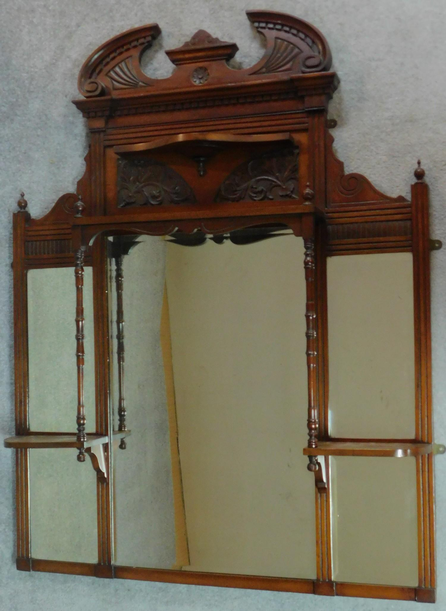 A Victorian carved walnut overmantel with broken arch pediment. H.135 W.111 D.16cm