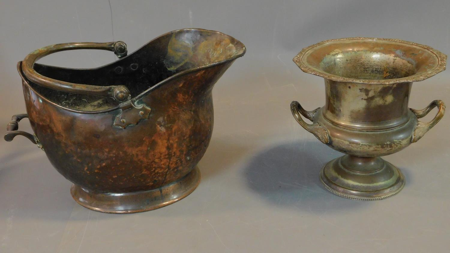 A copper and brass helmet shaped coal bucket and a campana form ice bucket. H.27cm (tallest)