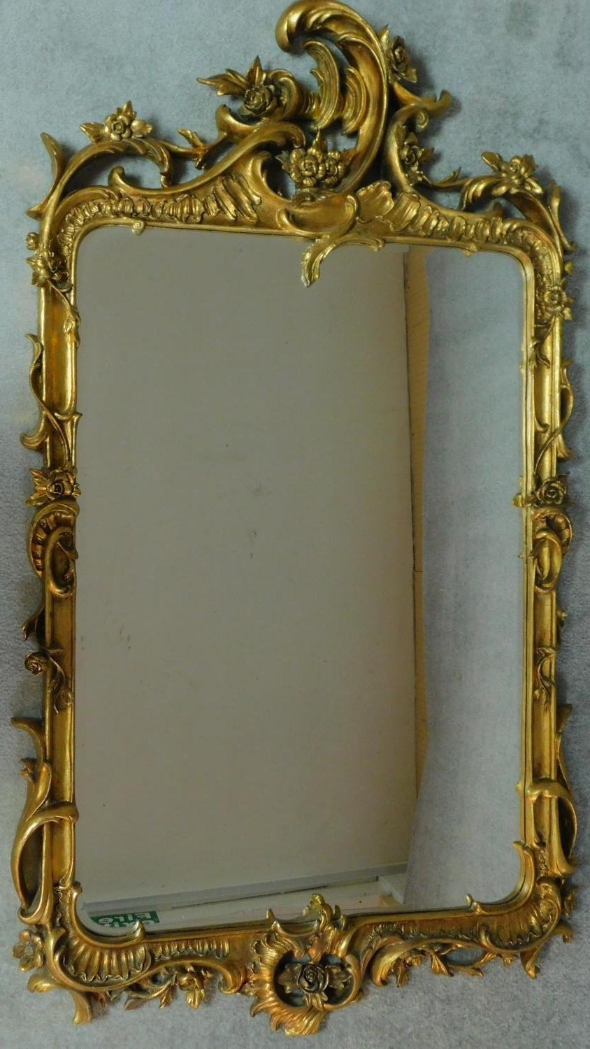 An elaborately carved giltwood rococo style wall mirror 156x85