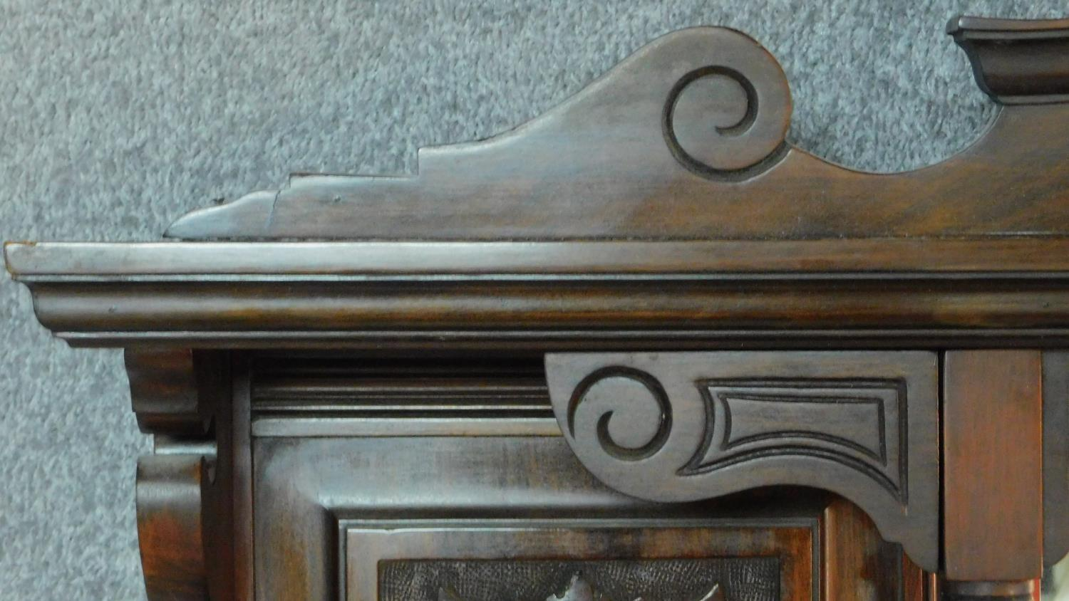 A Victorian carved walnut overmantel mirror with original bevelled plates. H.142 W.149 D.20cm - Image 3 of 7