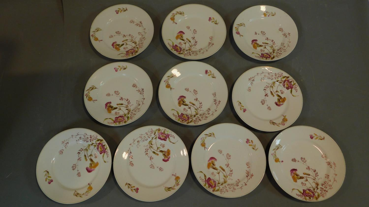 A set of 19th century floral decorated plates. 23x23cm
