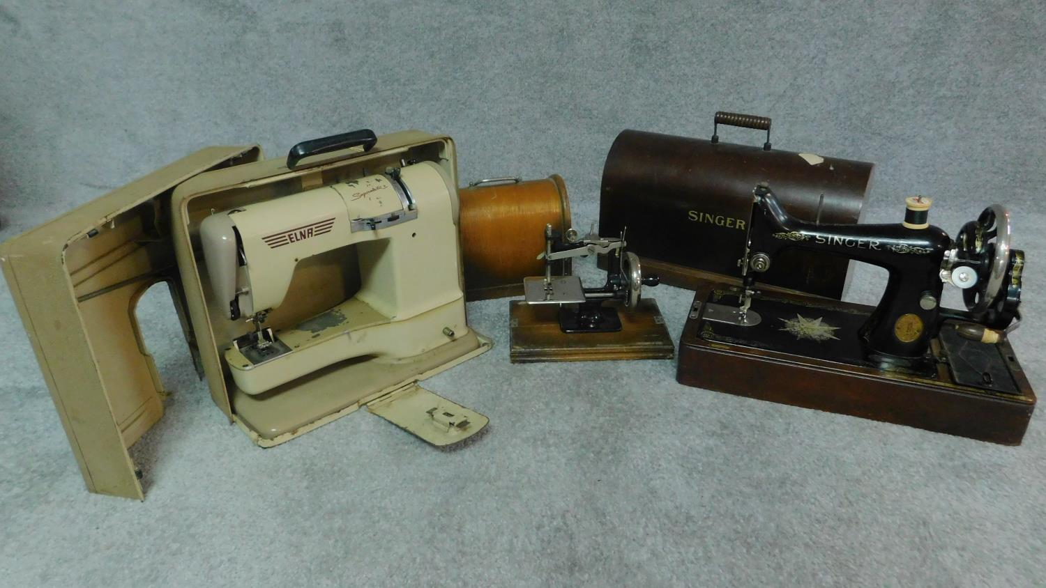 Three miscellaneous sewing machines.