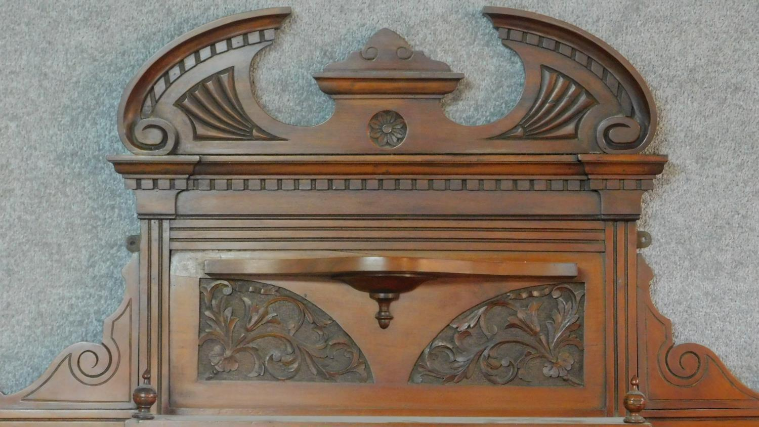 A Victorian carved walnut overmantel with broken arch pediment. H.135 W.111 D.16cm - Image 2 of 6