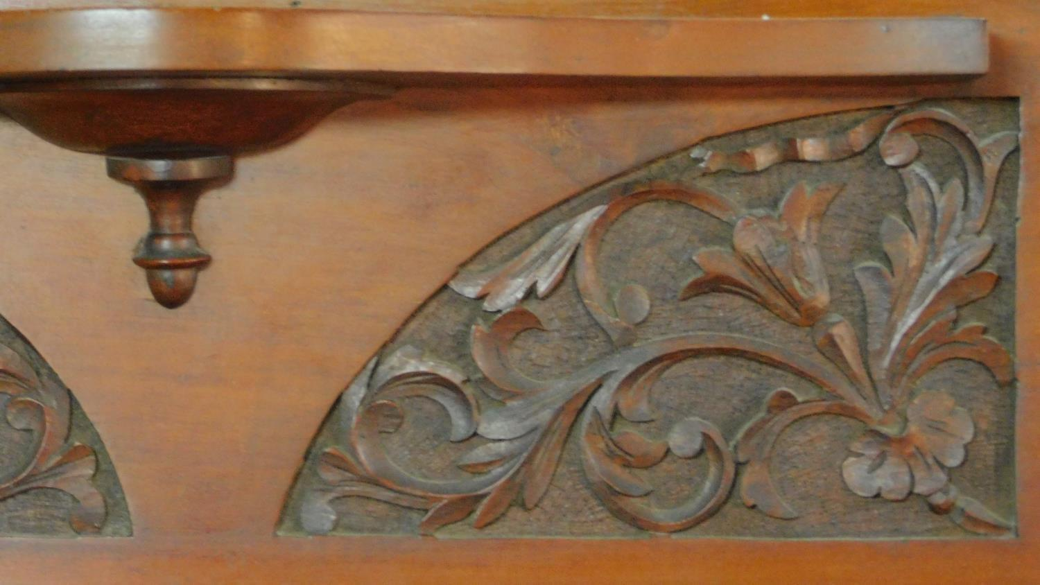 A Victorian carved walnut overmantel with broken arch pediment. H.135 W.111 D.16cm - Image 4 of 6