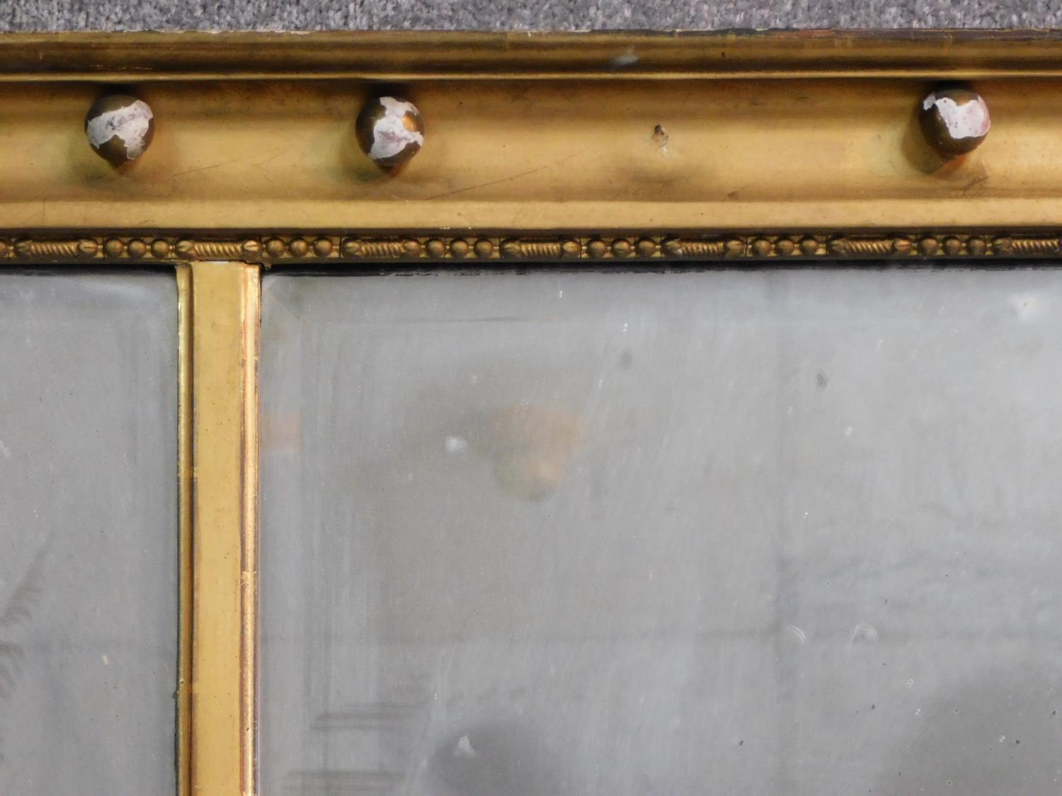 A Regency gilt triple section overmantel mirror with original bevelled plates flanked by reeded - Image 3 of 5