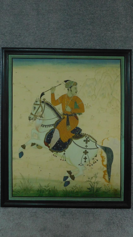 A framed Indian equestrian painting on silk, horseman on Rajasthan Marwari. h118x96cm