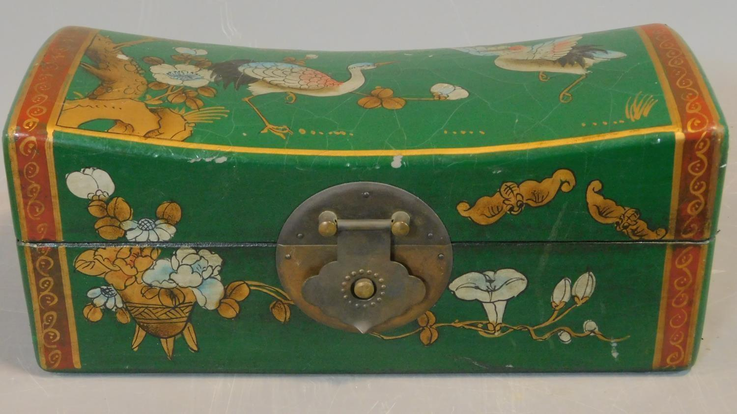 A green painted and lacquered Chinese box with floral motifs. H.12 W.28 D.11.5cm