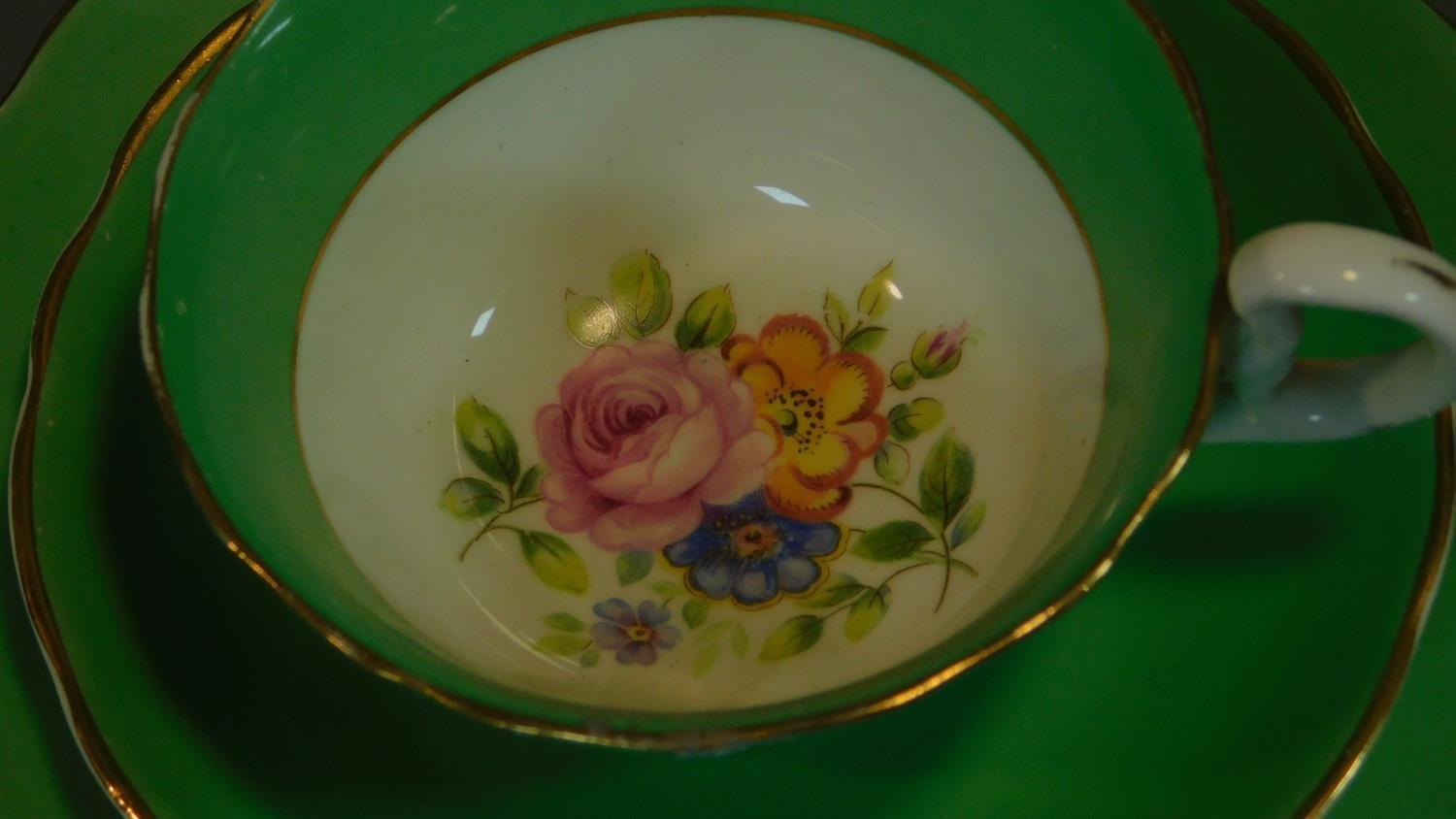 A green floral decorated tea set for six and a seven piece pink floral tea set. - Image 6 of 9