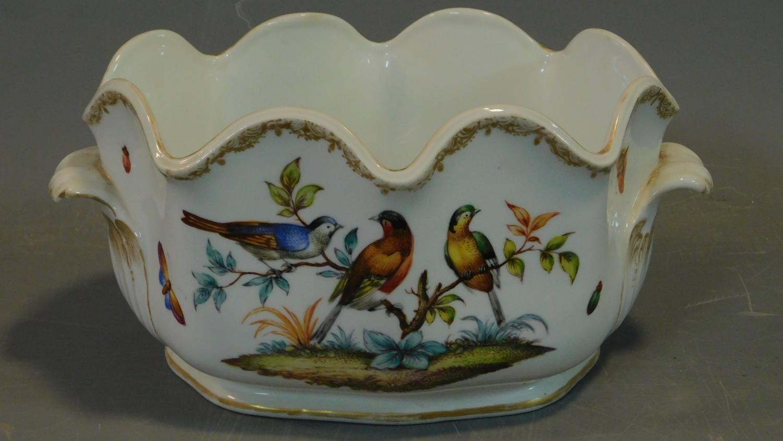 A Meissen style porcelain vase, hand painted with bird decoration. 14x18cm