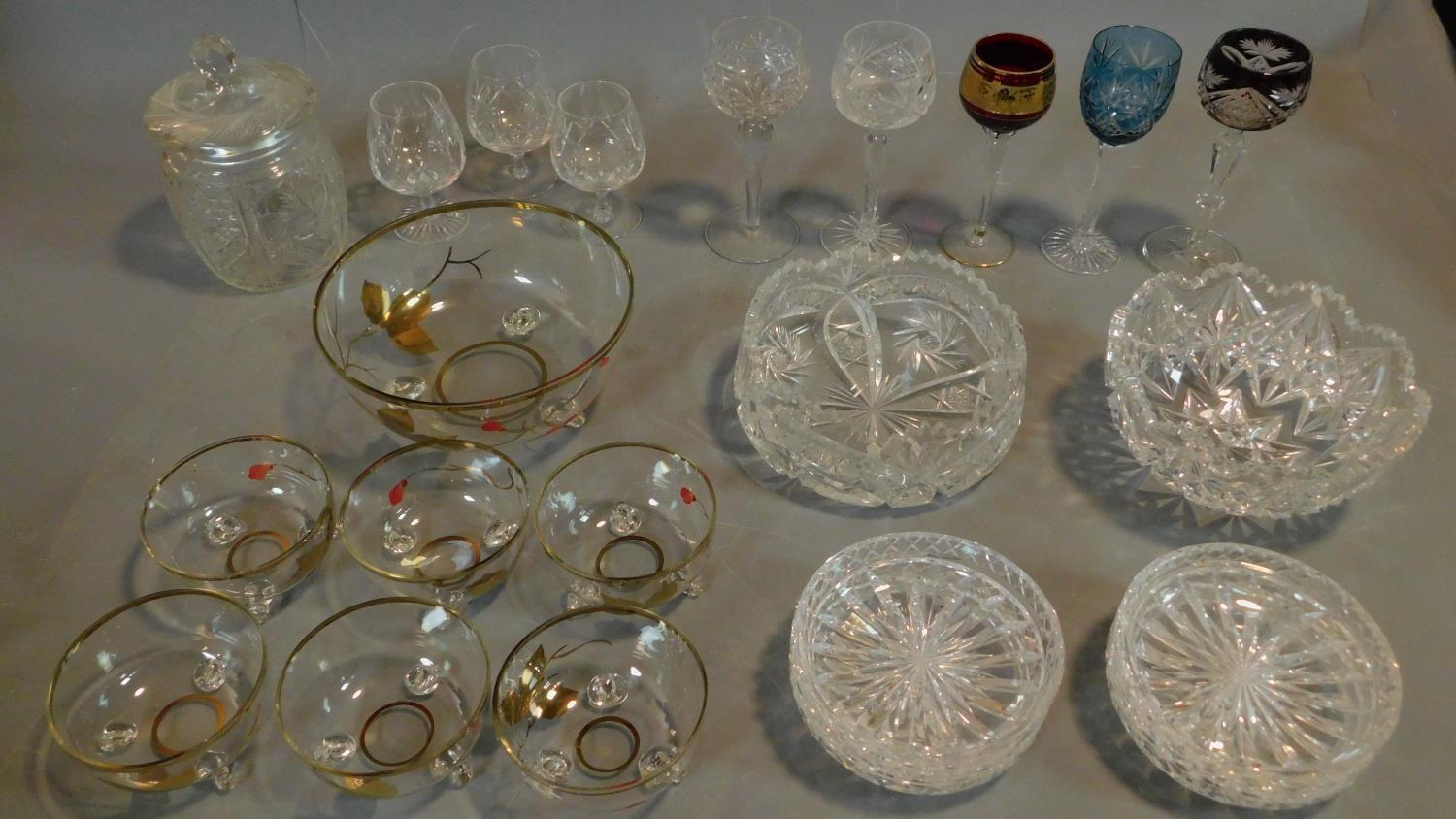 A vintage painted decorated dessert set and a collection of miscellaneous glass items.