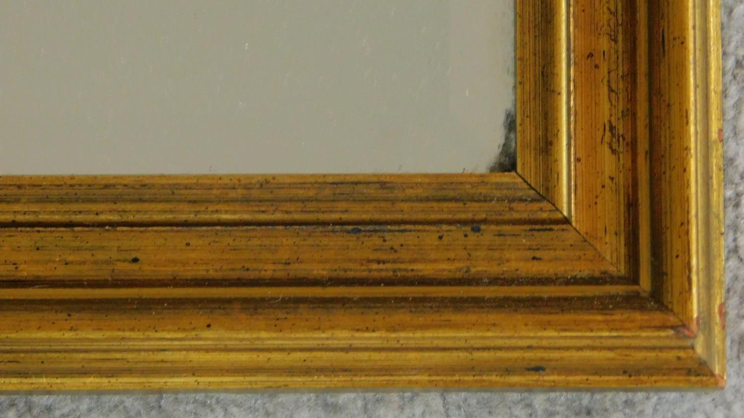 A rectangular gilt framed mirror with bevelled plate. 84x109 - Image 2 of 4