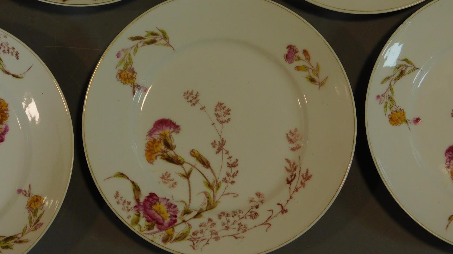 A set of 19th century floral decorated plates. 23x23cm - Image 2 of 3