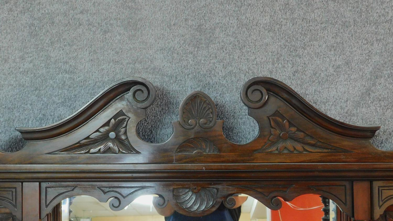 A Victorian carved walnut overmantel mirror with original bevelled plates. H.142 W.149 D.20cm - Image 2 of 7