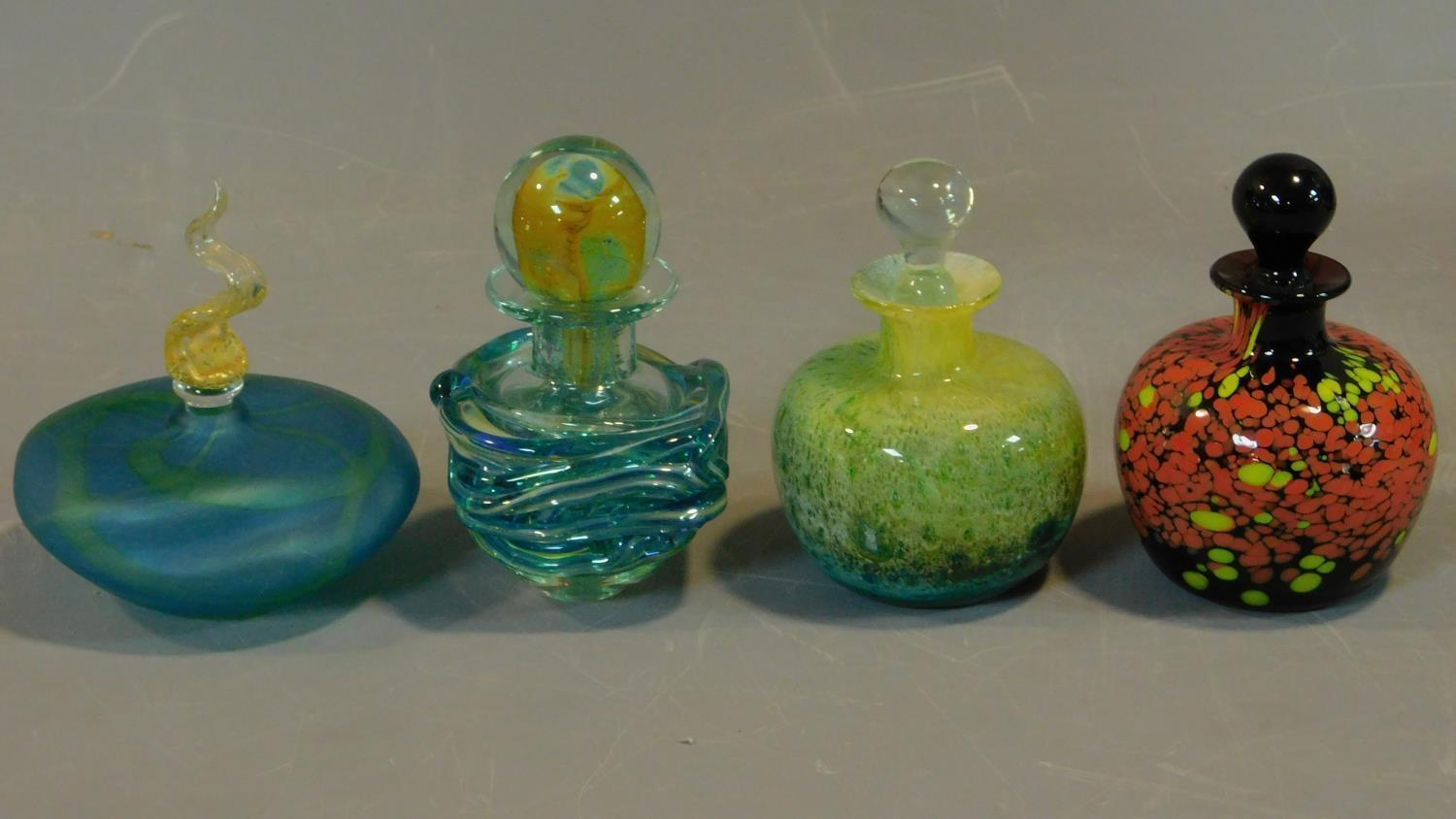 A collection of four coloured glass scent bottles. H.14 (tallest)