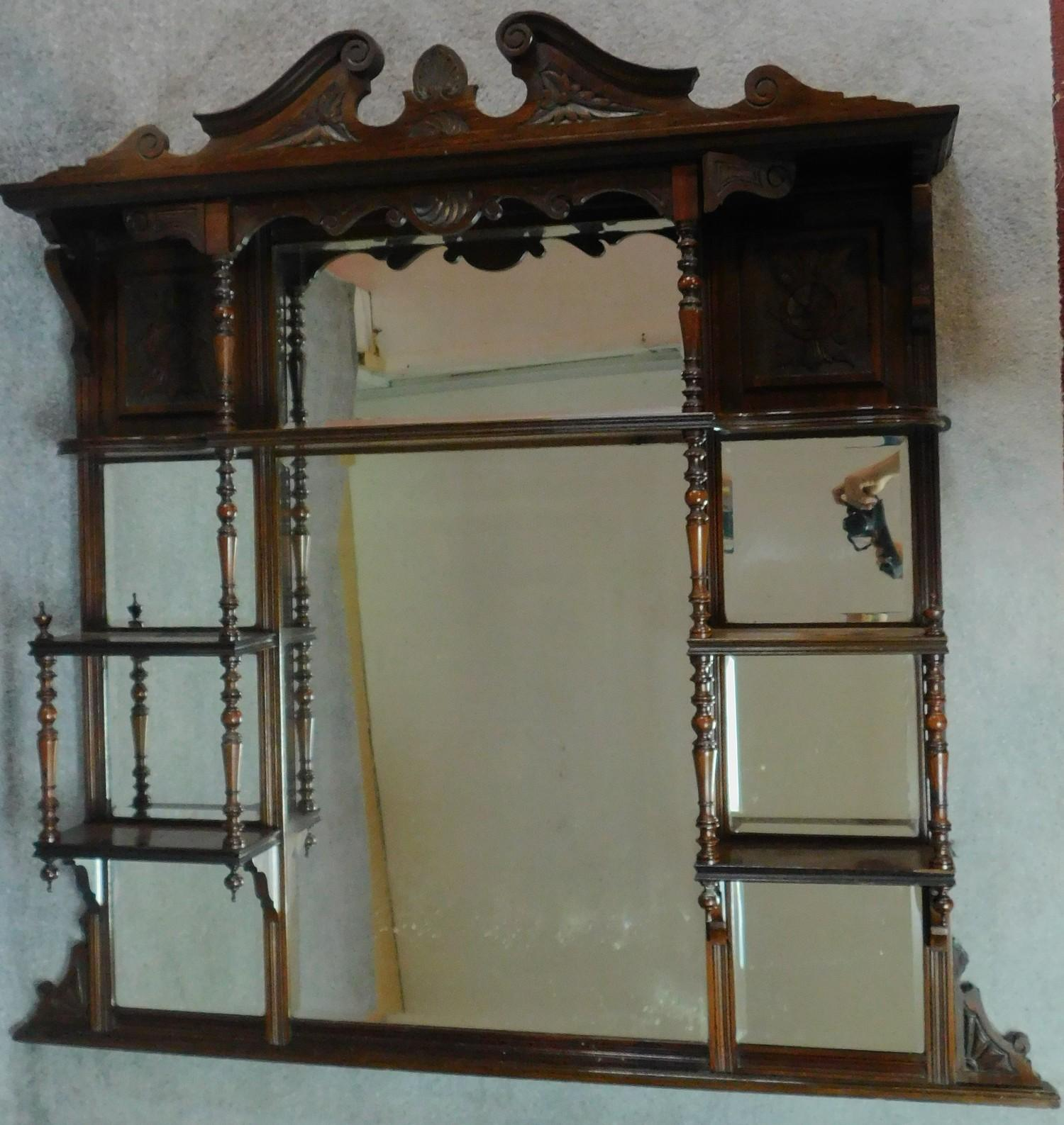 A Victorian carved walnut overmantel mirror with original bevelled plates. H.142 W.149 D.20cm