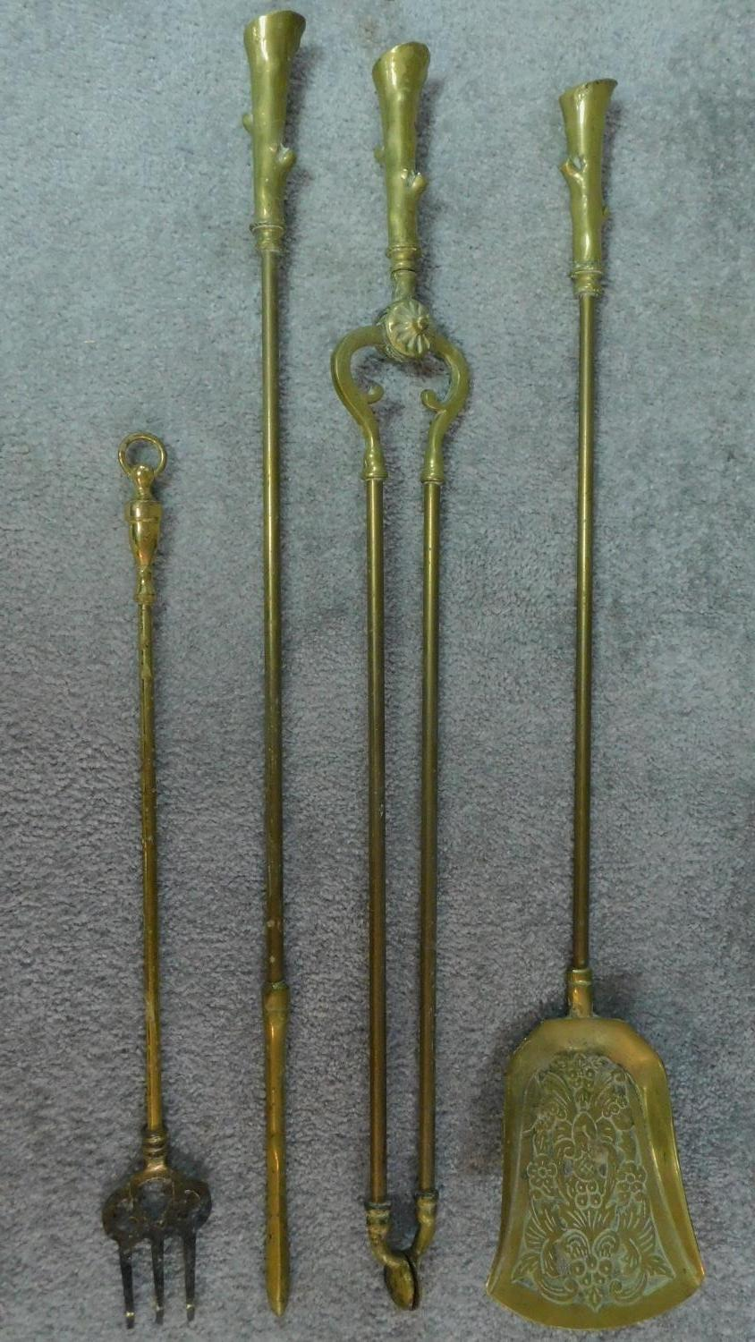 A set of 19th century brass fire implements and the matching andirons and a three section fireguard. - Image 3 of 6