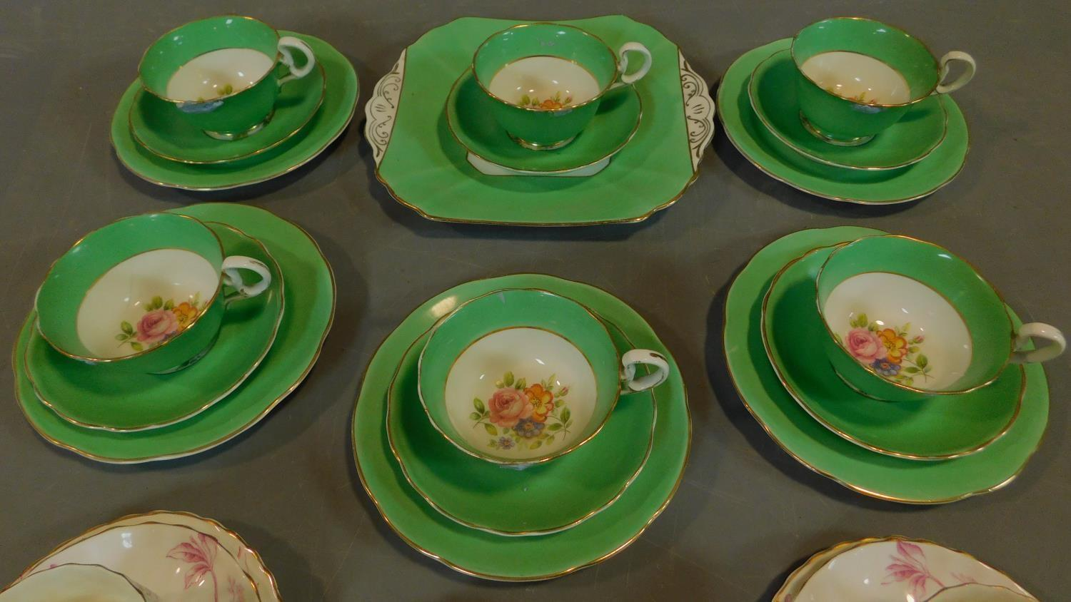 A green floral decorated tea set for six and a seven piece pink floral tea set. - Image 2 of 9