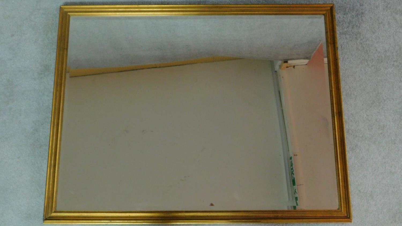 A rectangular gilt framed mirror with bevelled plate. 84x109