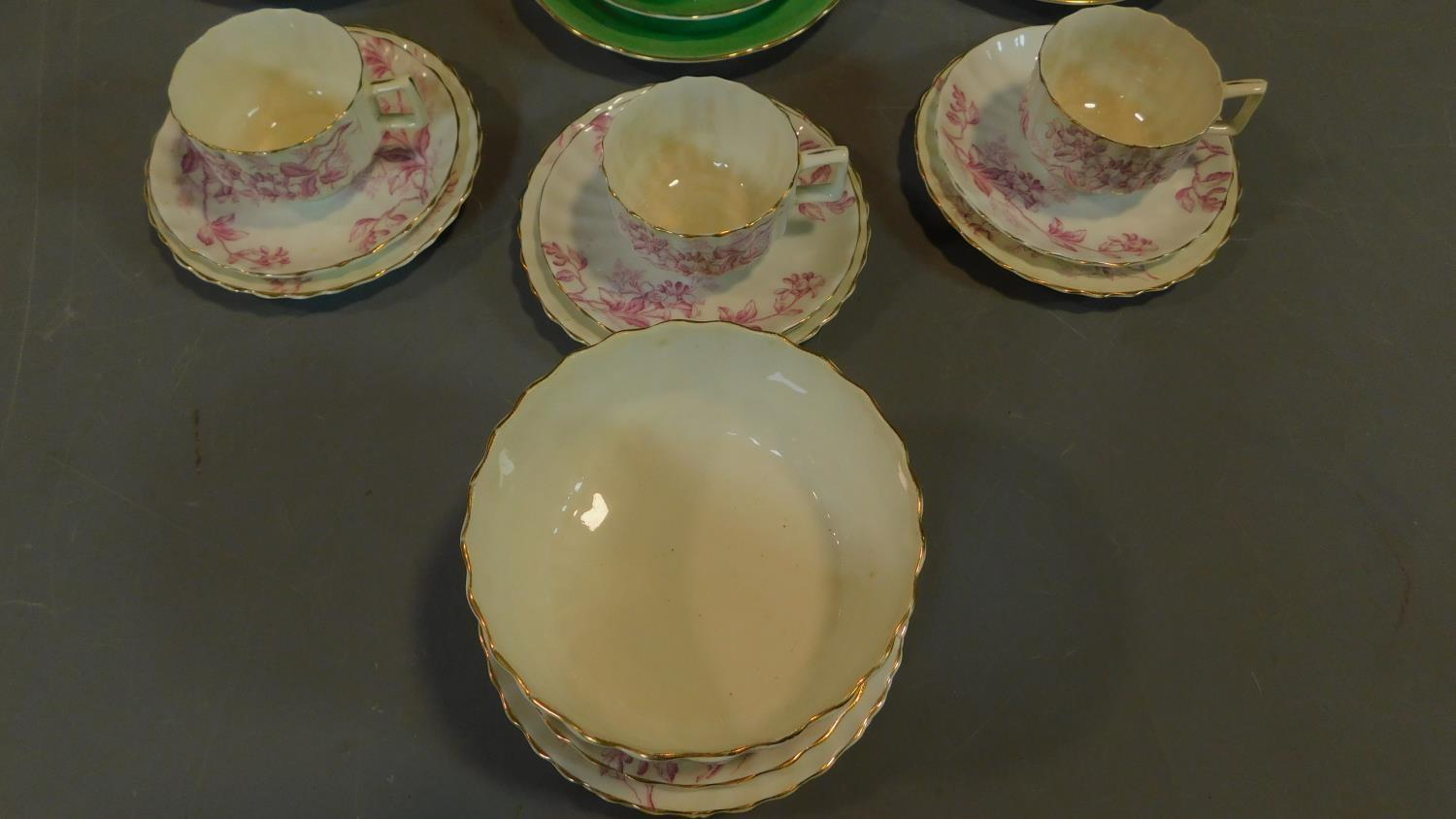 A green floral decorated tea set for six and a seven piece pink floral tea set. - Image 3 of 9