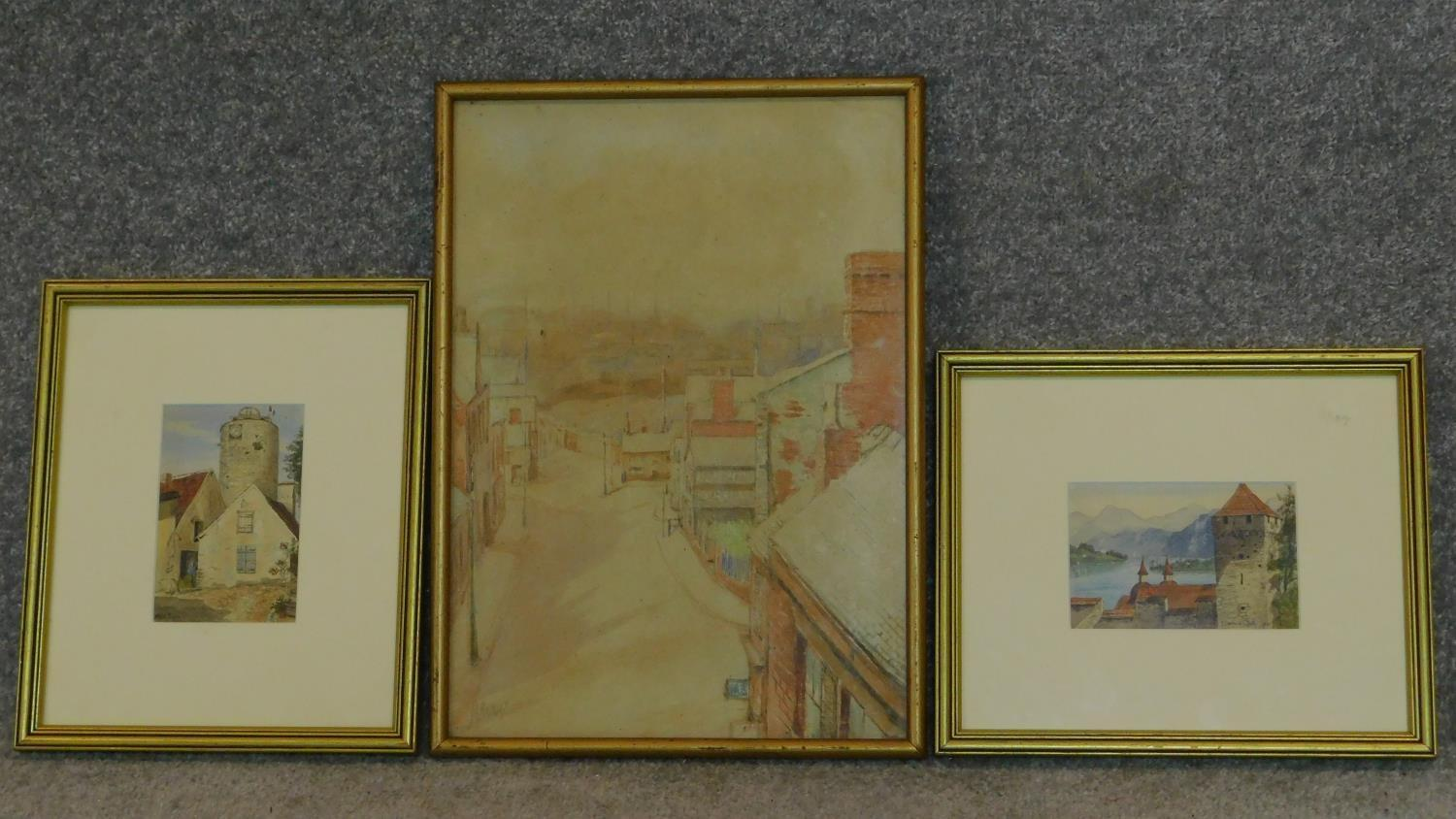 Three framed and glazed watercolours: street scene, a continental castle and farm buildings. 39x29cm
