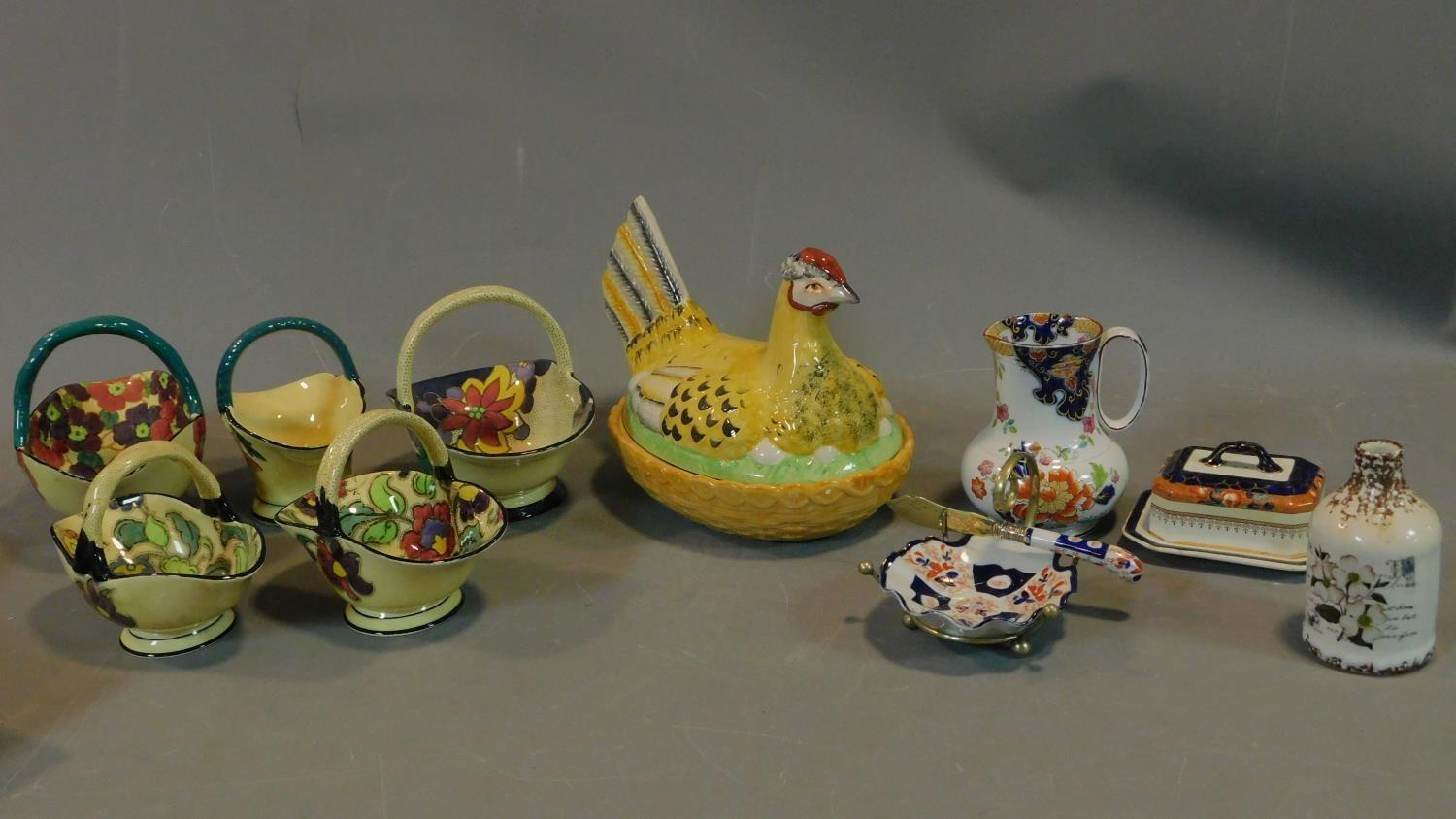 A collection of Art Deco Tuscan Decoro pottery baskets and other ceramic items.