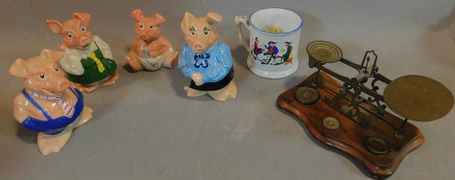 Four Wade pig money boxes, a frog mug and a set of weighing scales. H.17 (tallest)