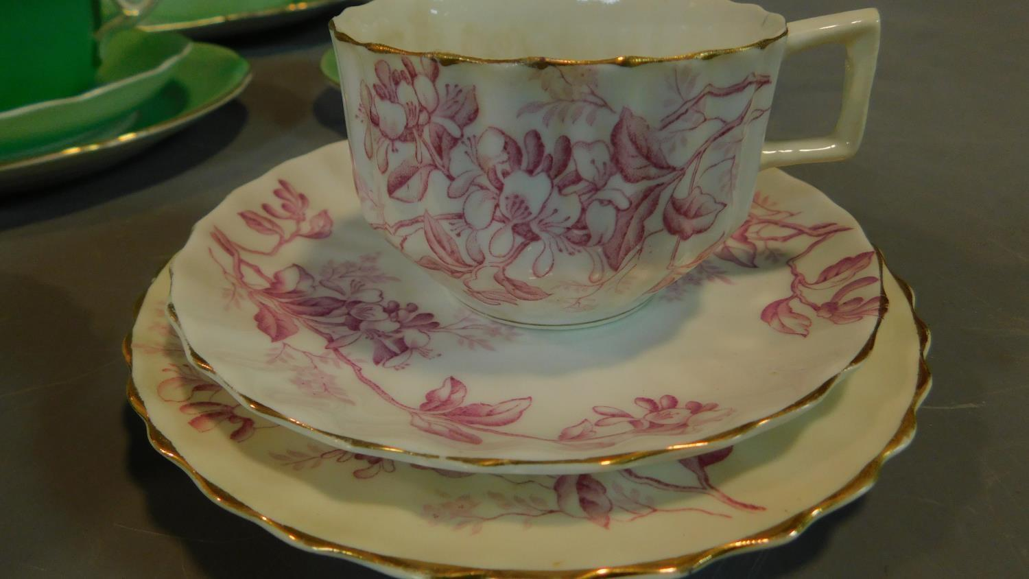 A green floral decorated tea set for six and a seven piece pink floral tea set. - Image 5 of 9