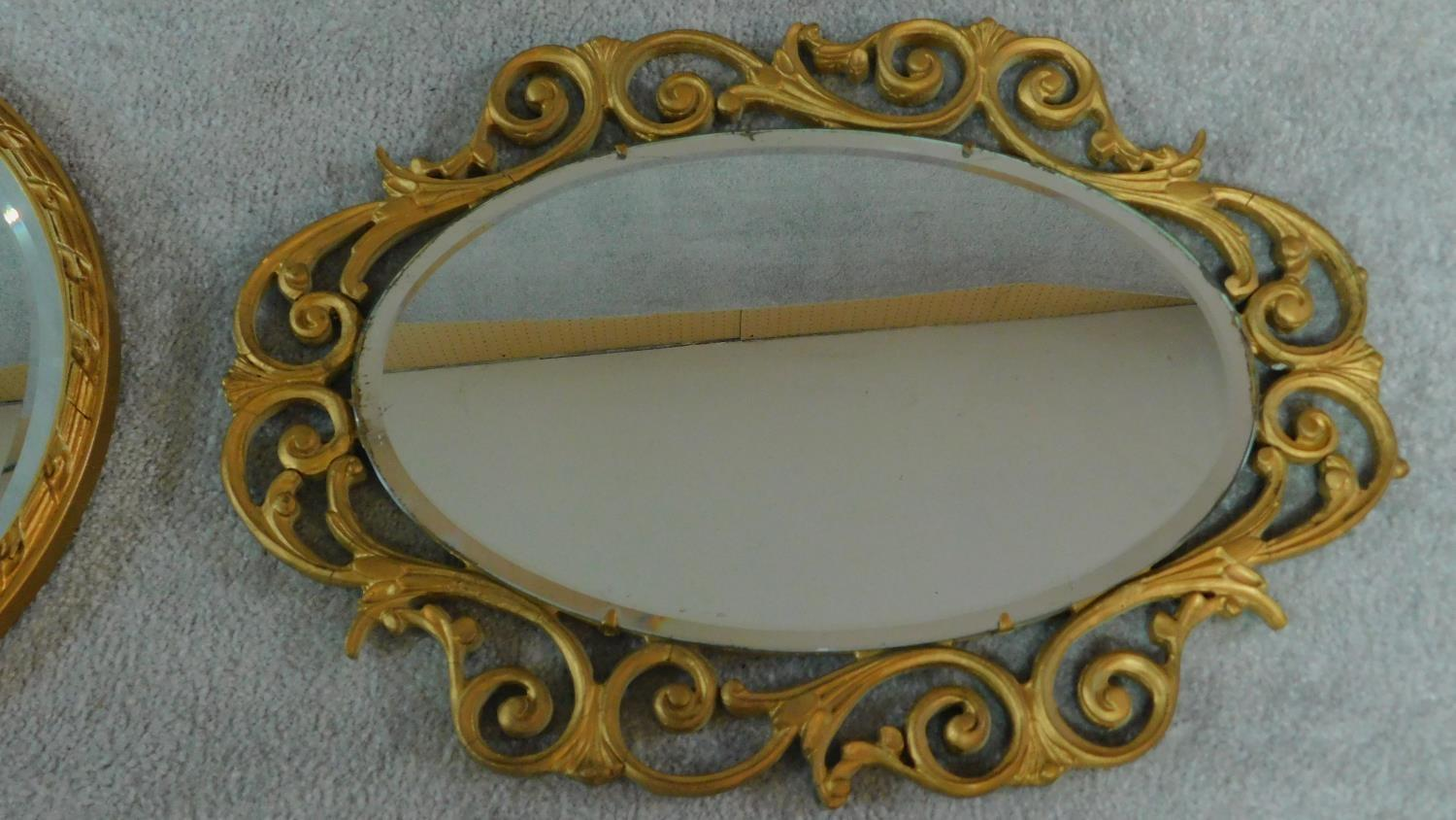 A rectangular gilt wall mirror and two oval gilt mirrors. 120x34cm - Image 2 of 5