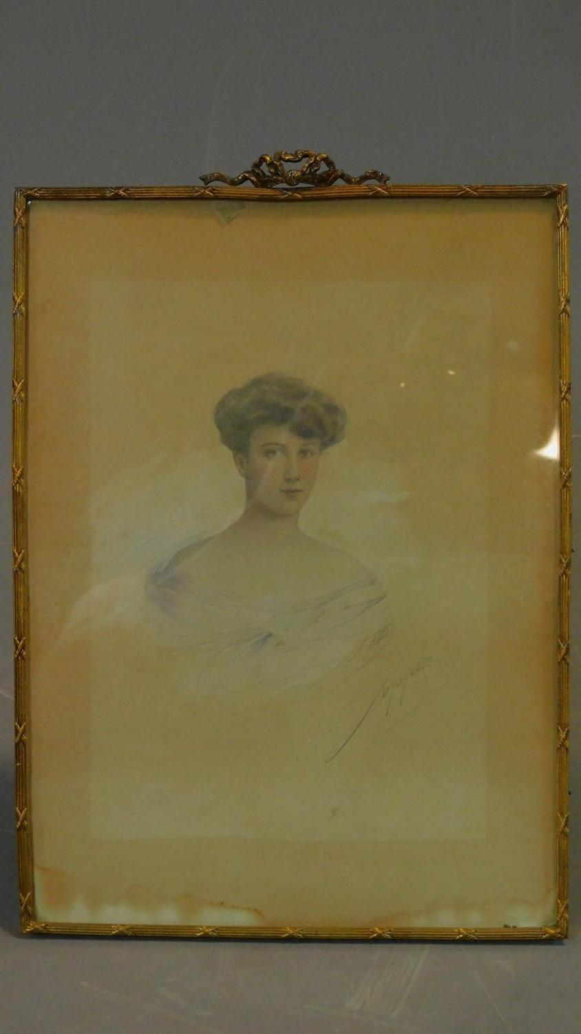 An early 20th century pencil and watercolour portrait in gilt metal easel frame. 30x21cm