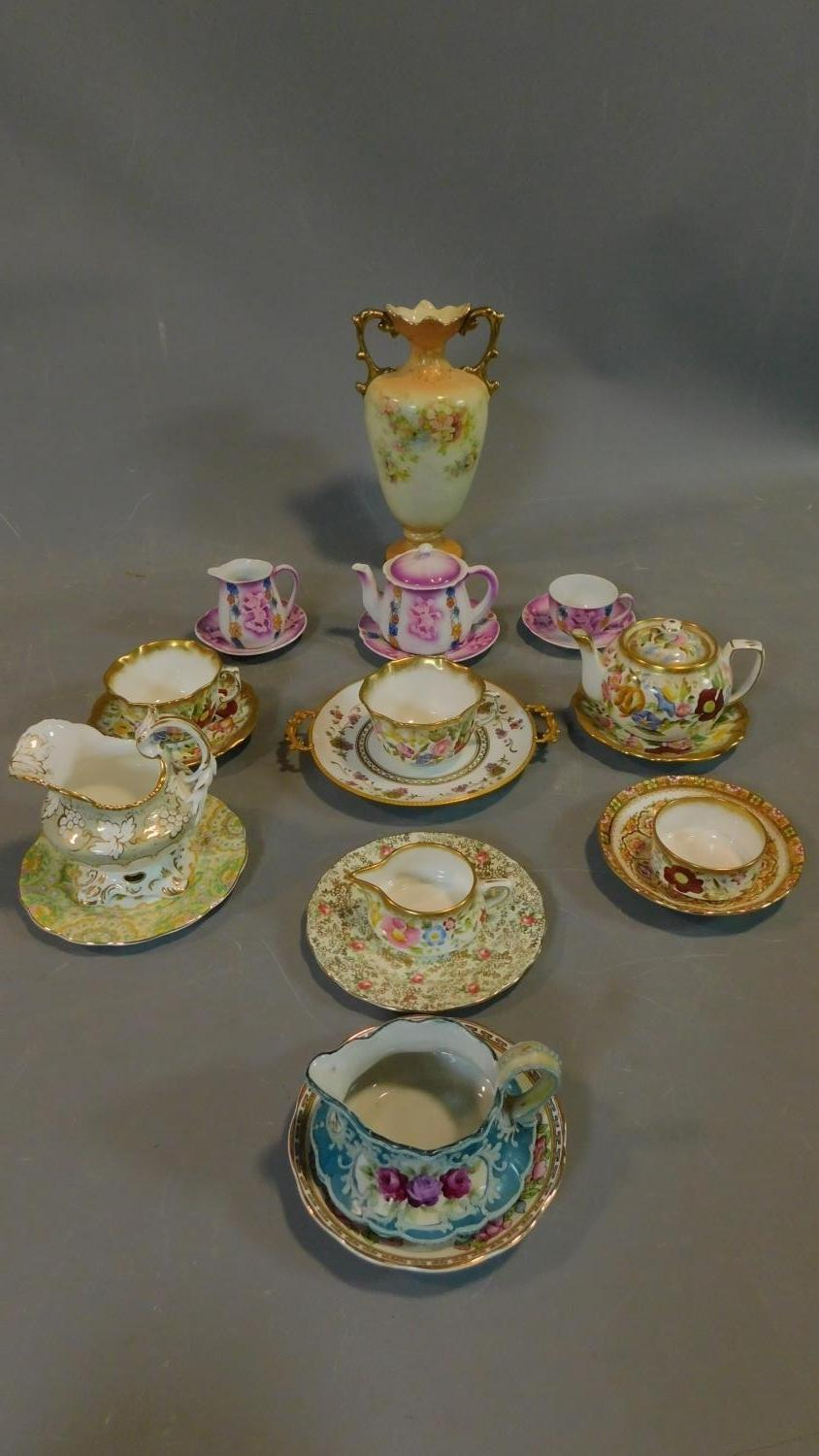 A miscellaneous collection of Victorian and later porcelain, vase, cups, saucers etc.