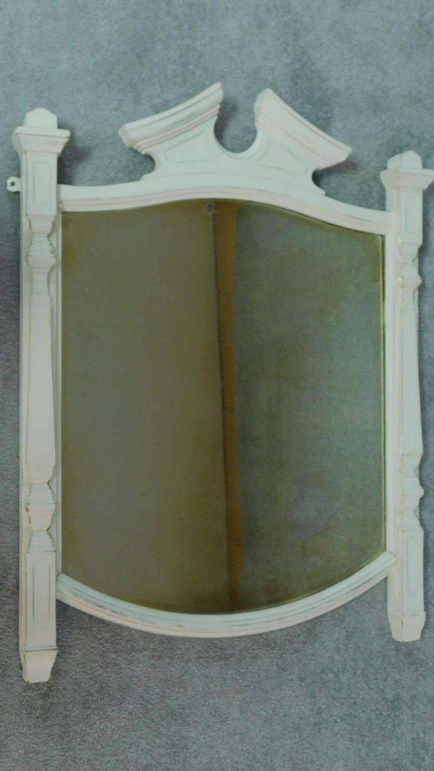 A white painted overmantel mirror. 91x72cm