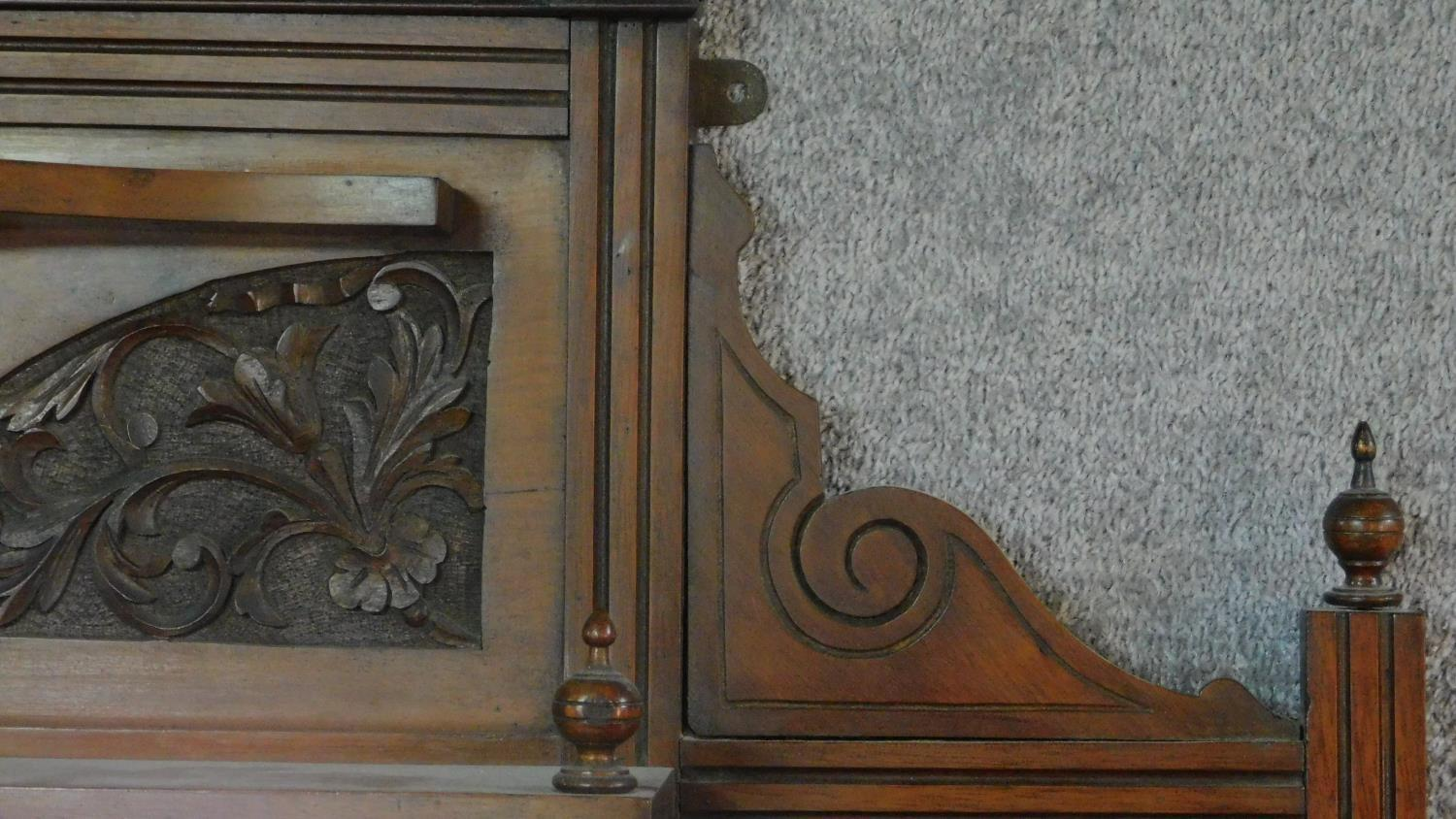 A Victorian carved walnut overmantel with broken arch pediment. H.135 W.111 D.16cm - Image 3 of 6
