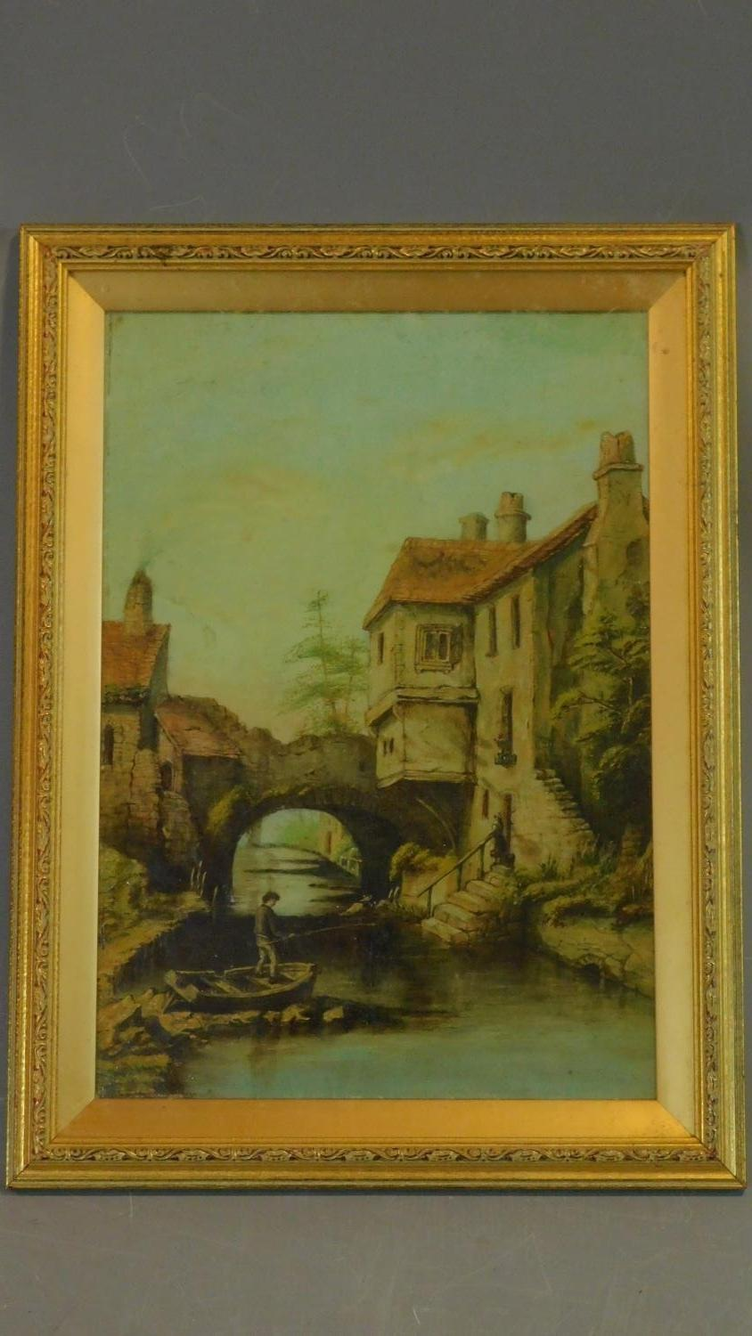 A gilt framed and glazed oil on board of a continental canal scene. 49x37cm