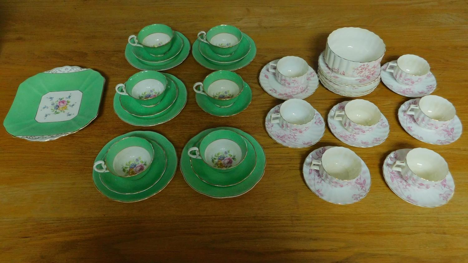 A green floral decorated tea set for six and a seven piece pink floral tea set.