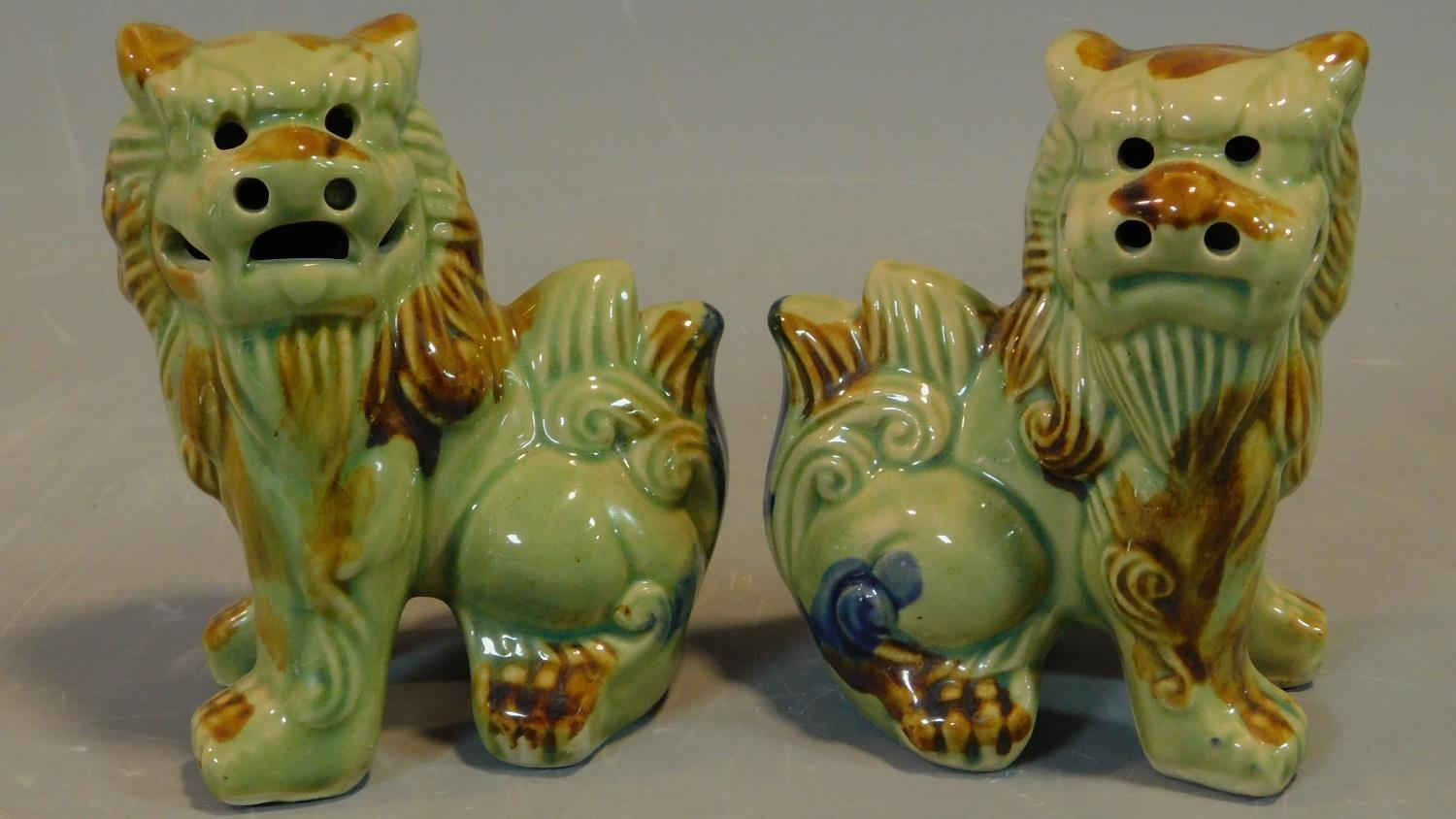 A pair of Chinese ceramic Fo dogs. H.14cm