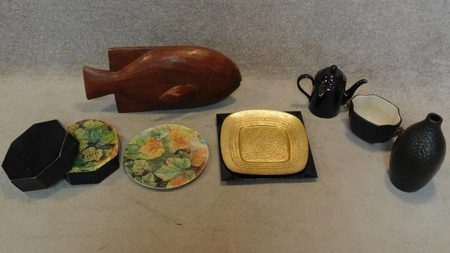 A boxed set of foliate design plates, a tureen with ram's head handles, a carved fish and other
