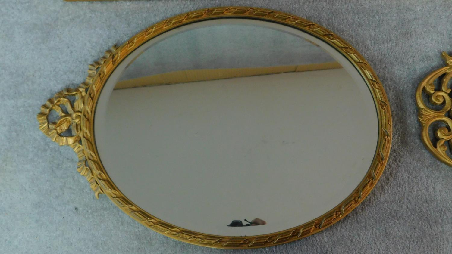 A rectangular gilt wall mirror and two oval gilt mirrors. 120x34cm - Image 3 of 5